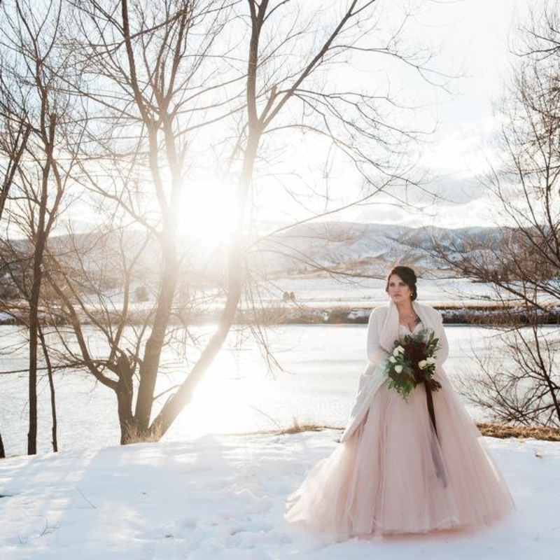 Winter is coming... Take a look this BEAUTIFUL shot from a Texas couples' elopement. The snow makes a perfect backdrop for a mountain