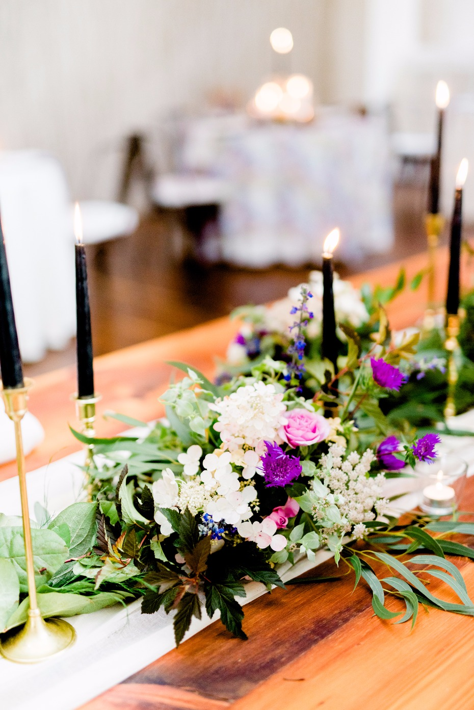 Purple and green centerpiece with black candles