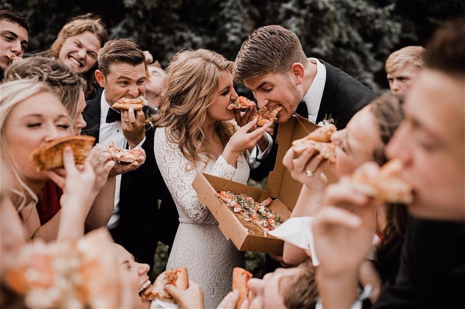 bride and groom eating pizza