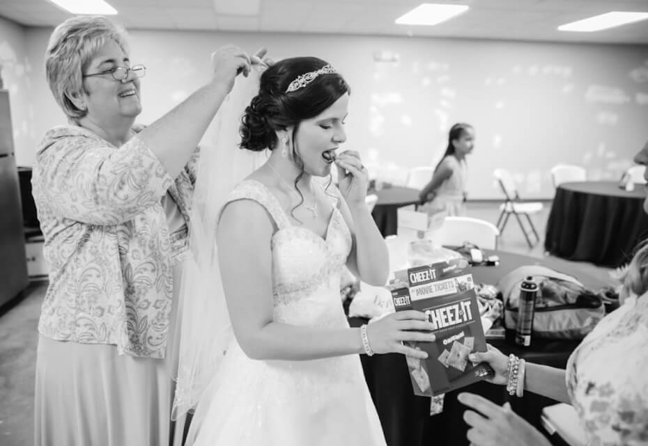 bride snacking in wedding dress