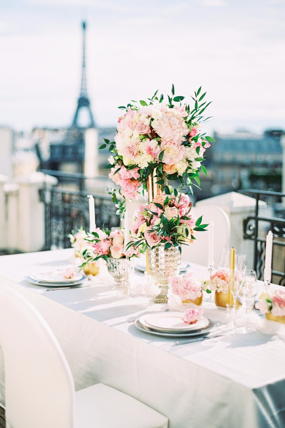 gold pink and white rooftop table setup