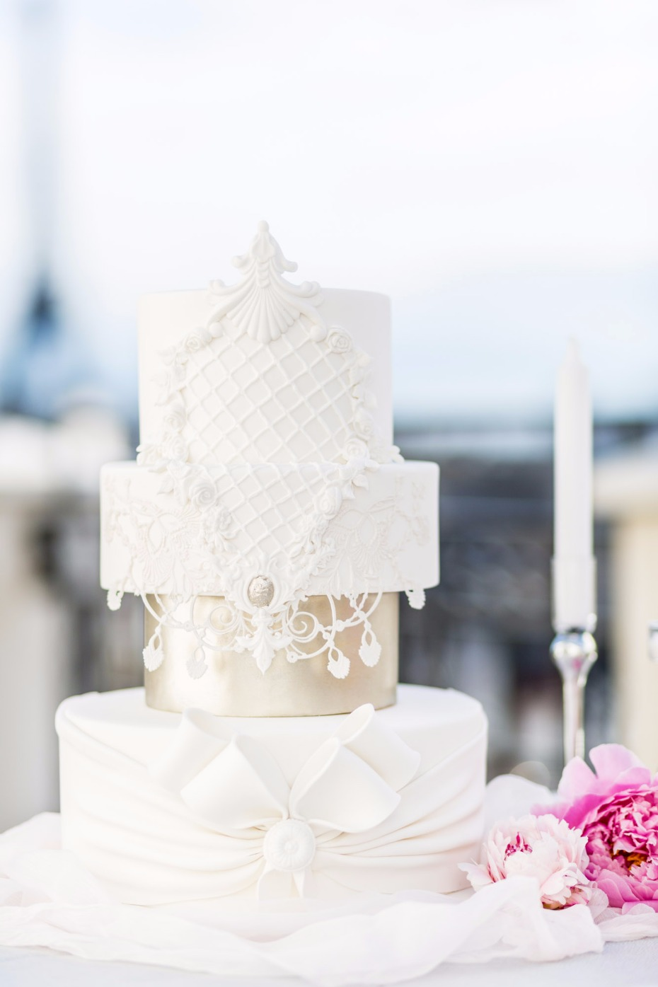 elegant gold and white wedding cake