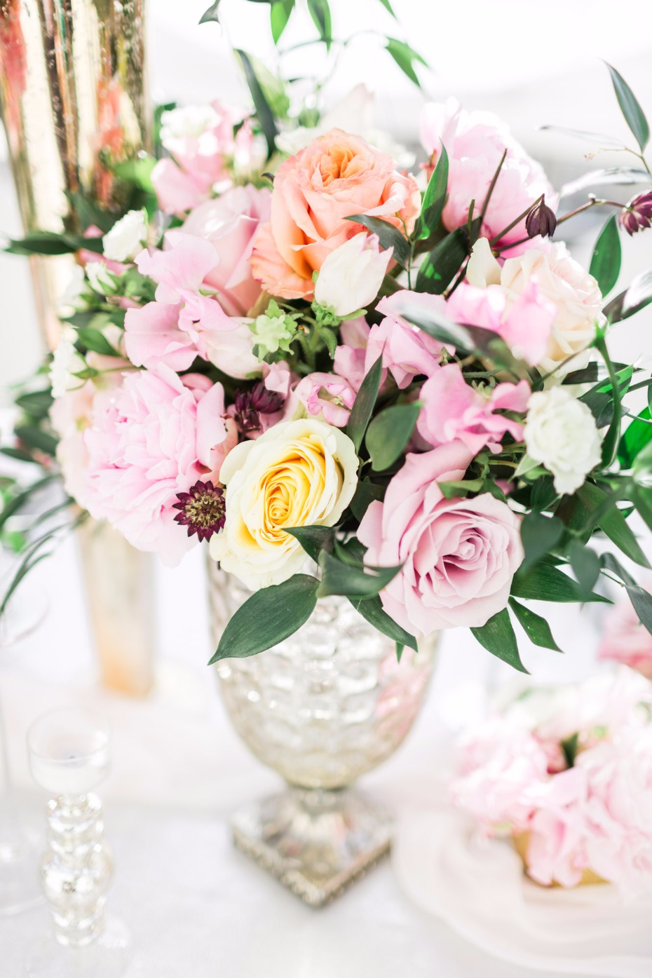 pink summer time wedding floral arrangement