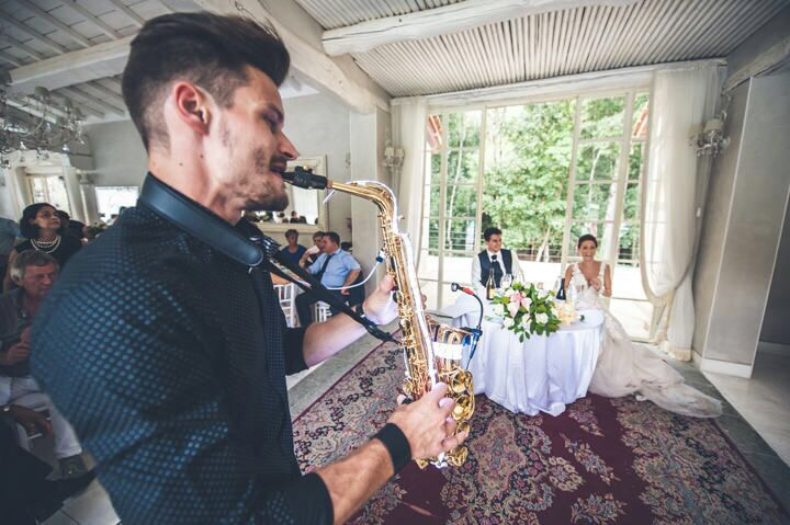 The delicate notes of a saxophone serve as a cue to the guests to dance.