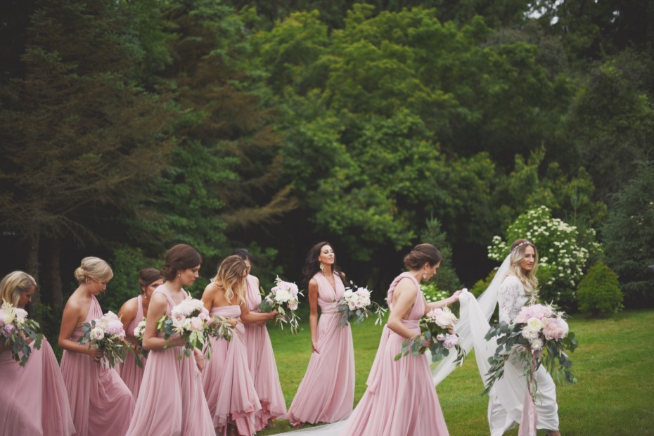 Bridesmaids in blush wrap dresses from Twobird