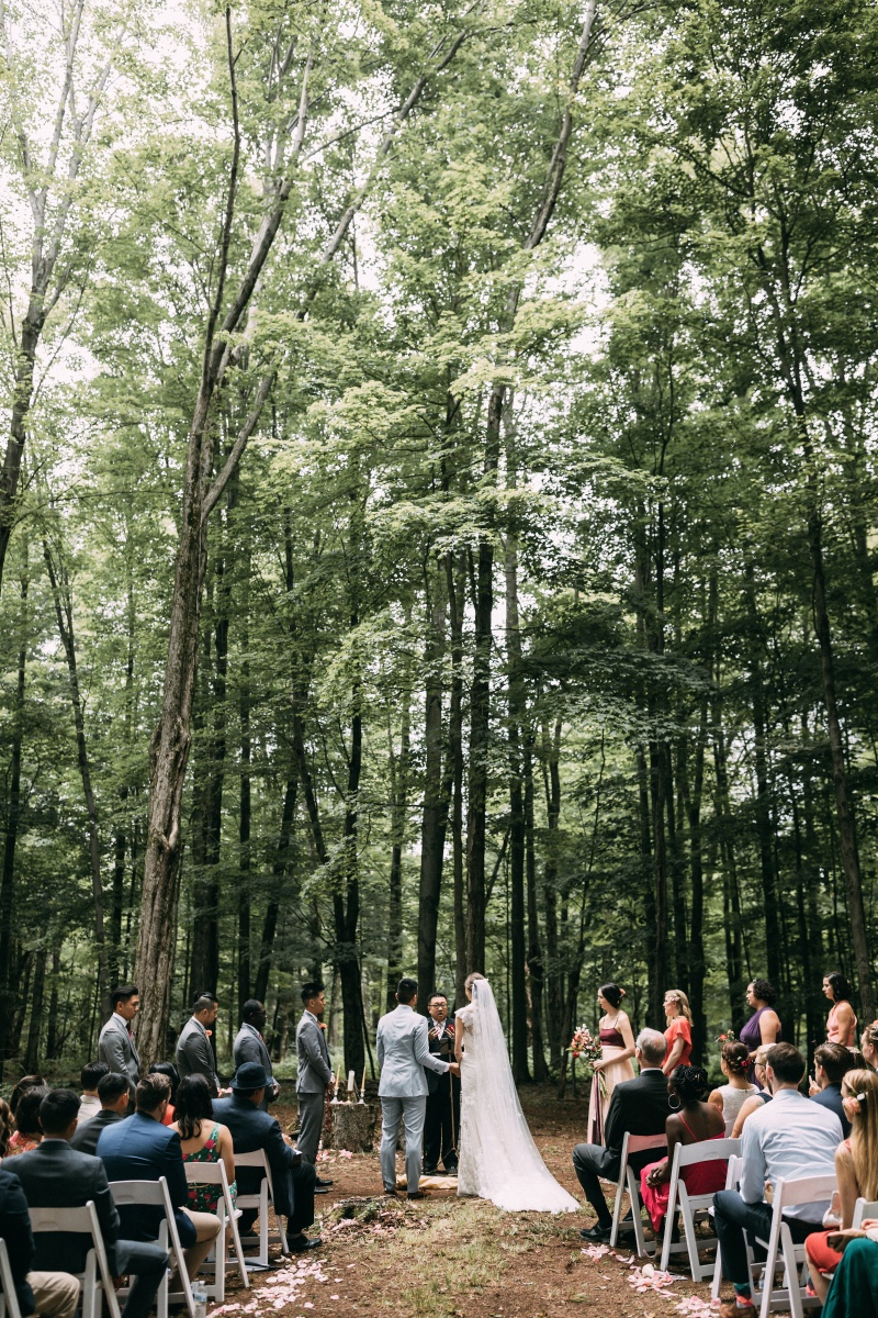 A ceremony in the woods! Venue: Gilbertsville Farmhouse Photo by: Larisa Shorina