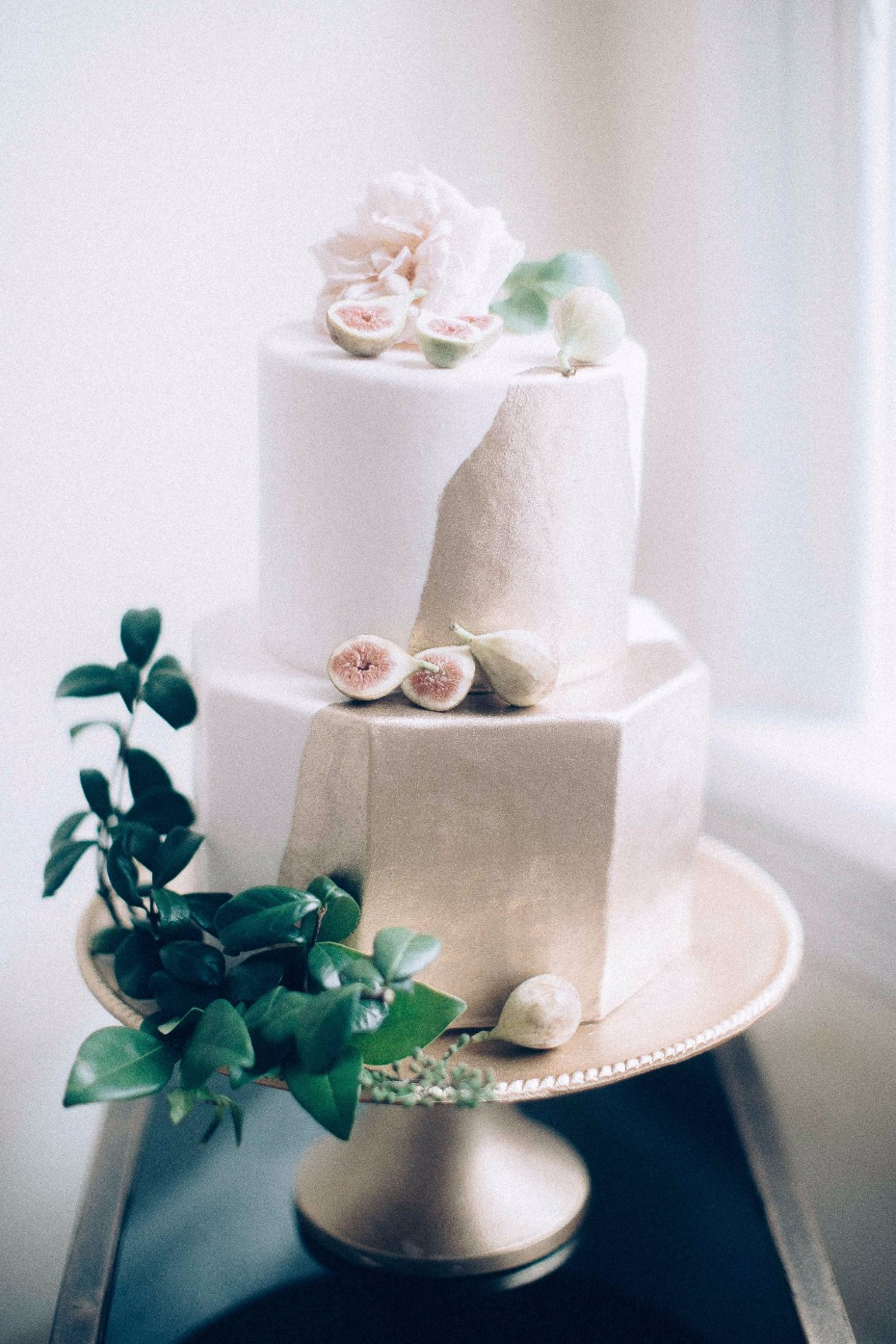 modern gold and white wedding cake