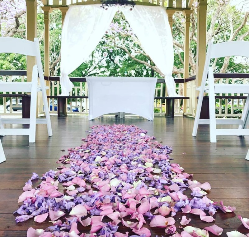 Rose Petal Wedding Aisle https://www.brisbaneweddingdecorators.com.au/ceremony-locations/new-farm-park-weddings/