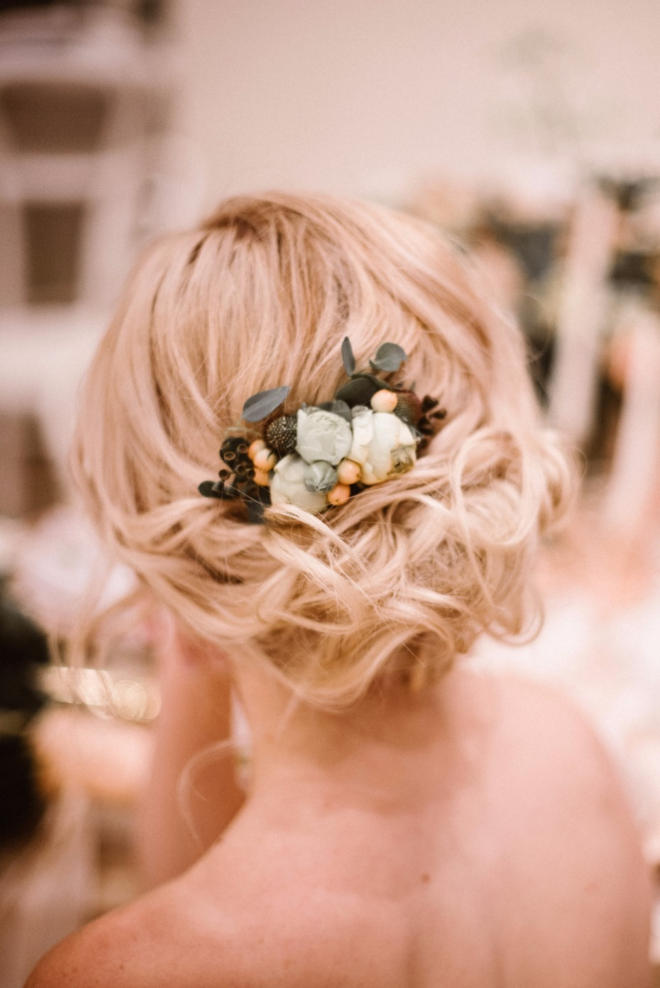 wedding hair updo with sweet floral accent