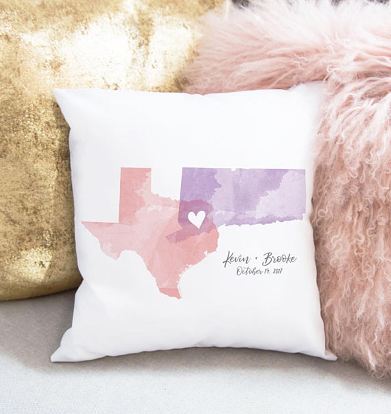 Miss Design Berry's unique gift for newlyweds is a throw pillow that is customized with watercolor art showcasing the two states or