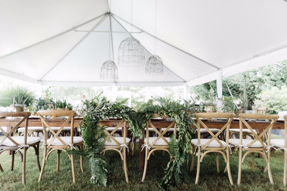 Fern adorned chairs for the bride and groom