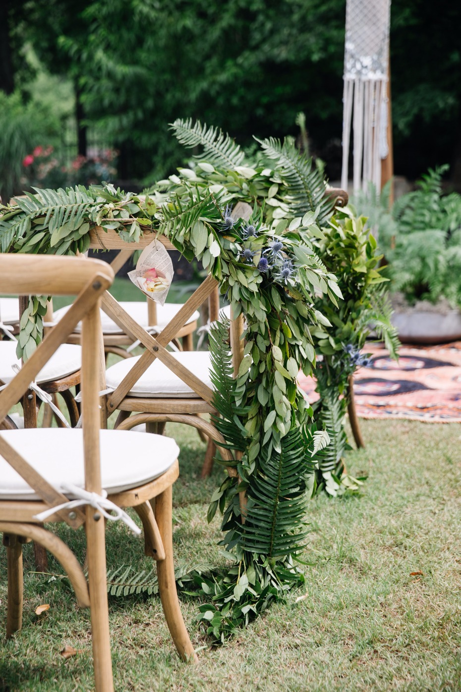Cover your chairs in greenery