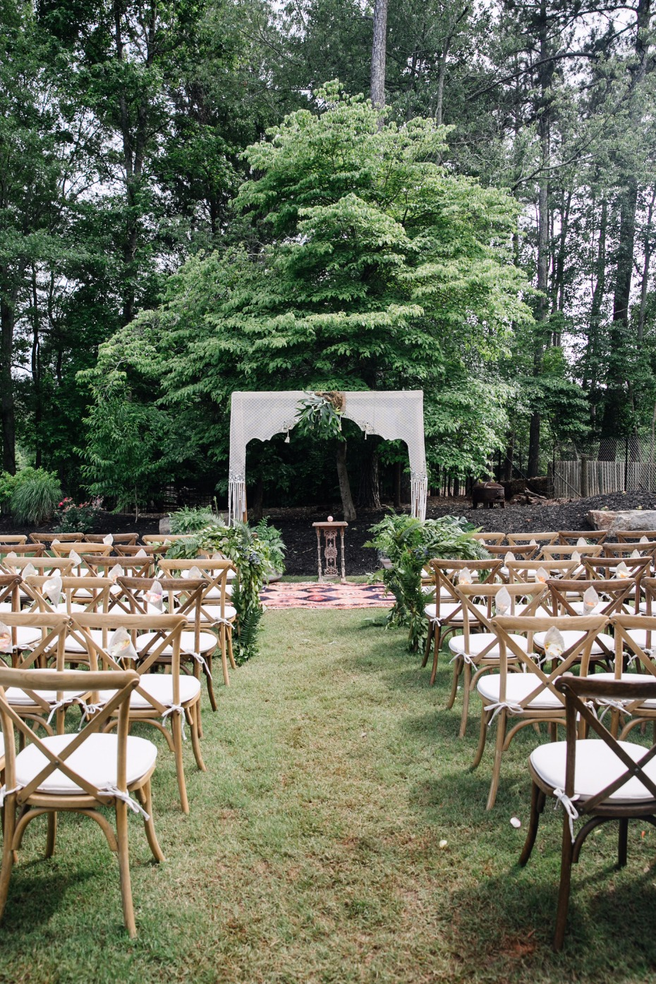 Boho styled ceremony with loads of plants