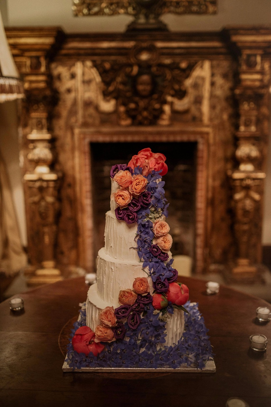 White cake with cascading flowers