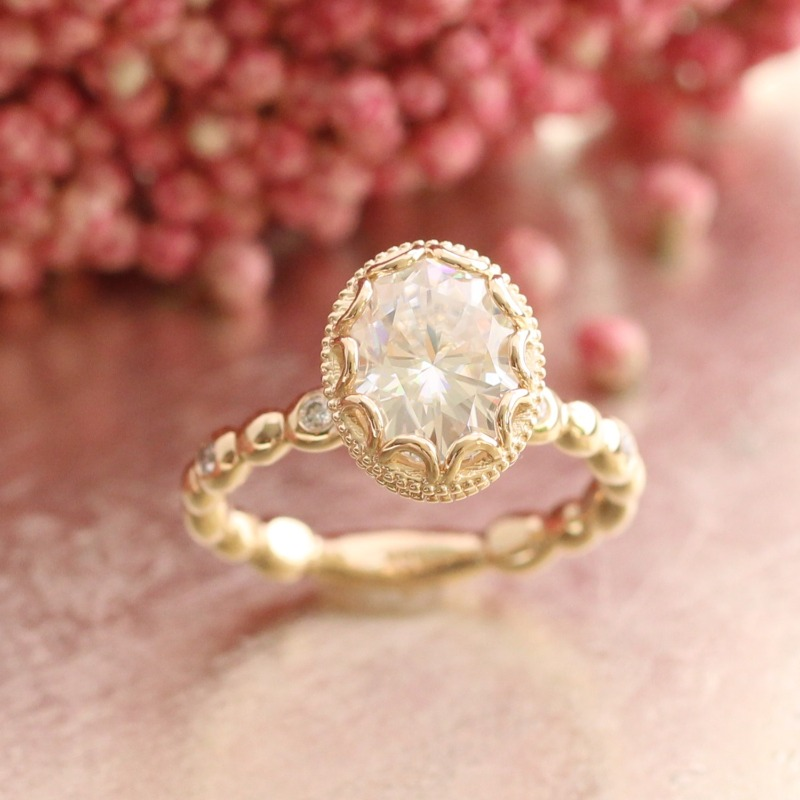 Floral 9x7mm Oval Moissanite Engagement Ring in Yellow Gold Pebble Diamond Band by La More Design in NYC
