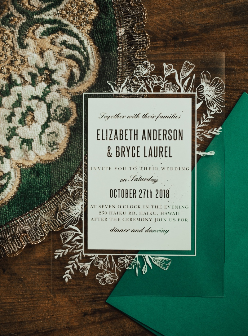 Clear wedding invitations paired with a festive colored envelope for your holiday wedding!