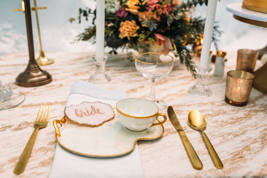 gold and opalescent wedding place setting