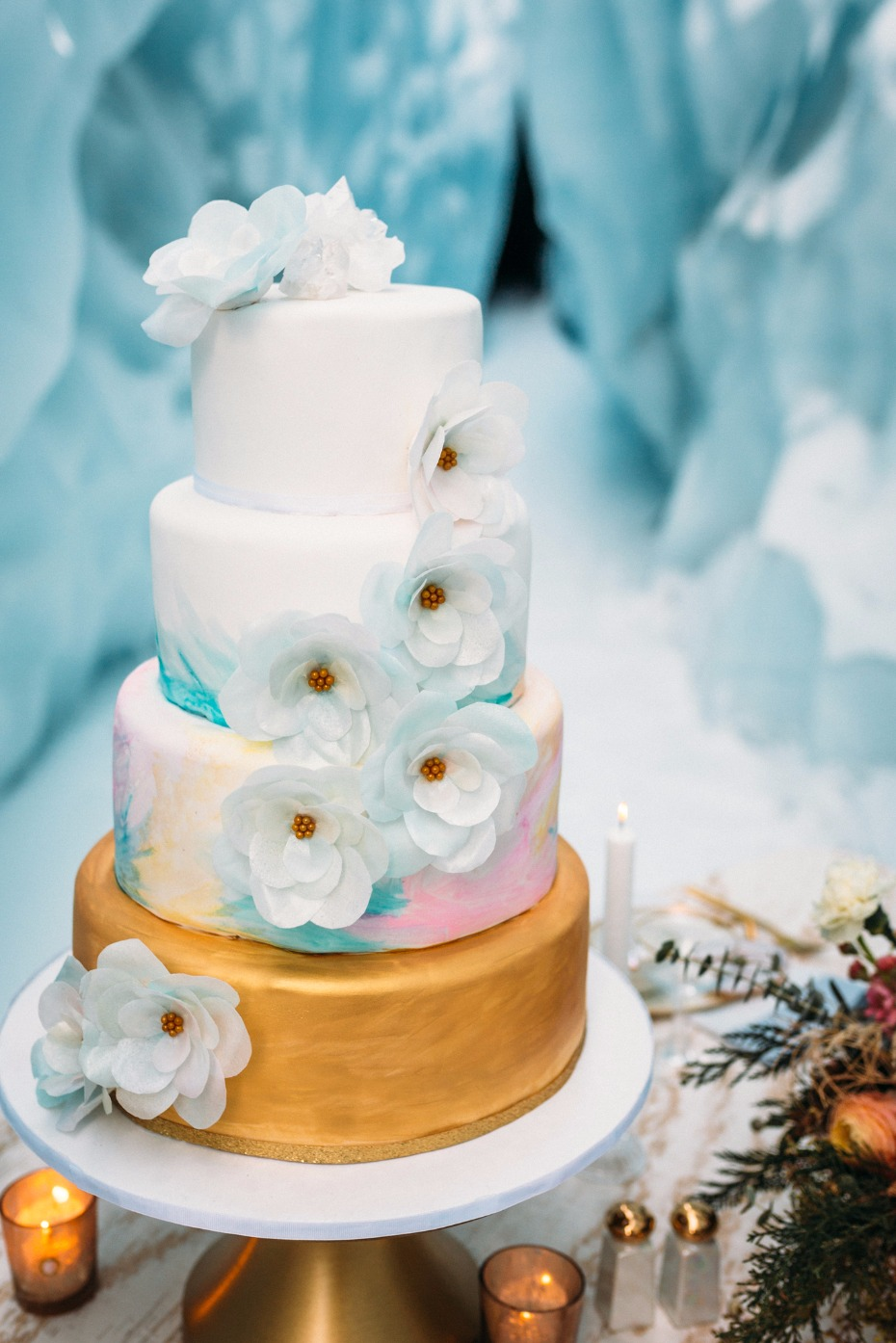 gold blue and pink wedding cake with sugar flower accents