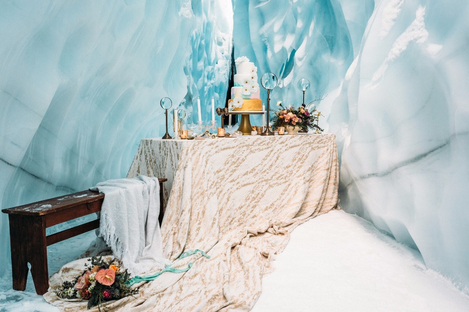 gold and white wedding cake table for your ice cave wedding