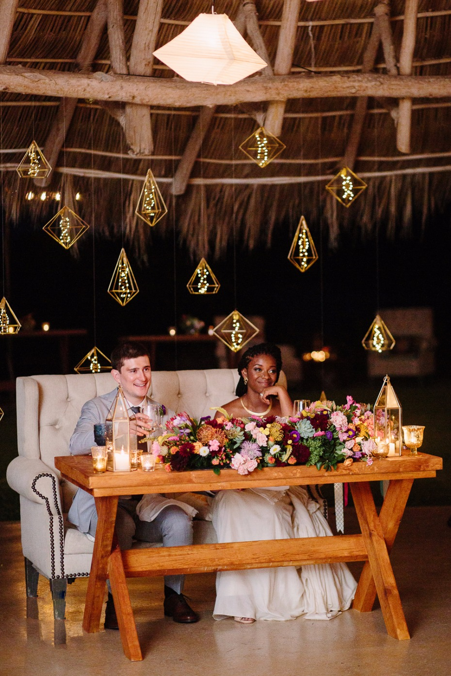 Love the hanging lights behind the sweetheart table