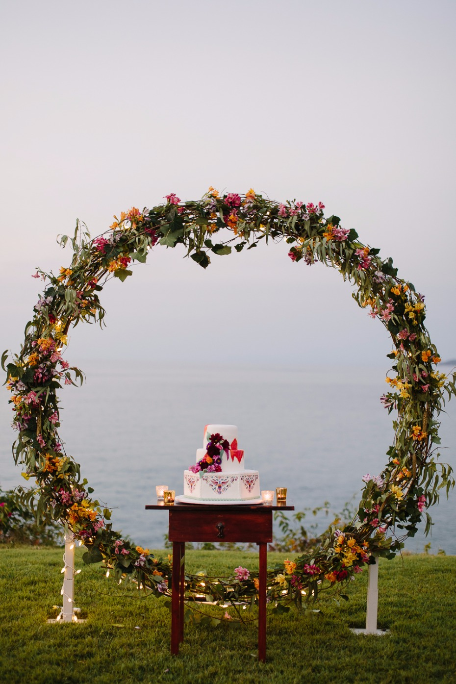 Use your ceremony arch as the cake backdrop
