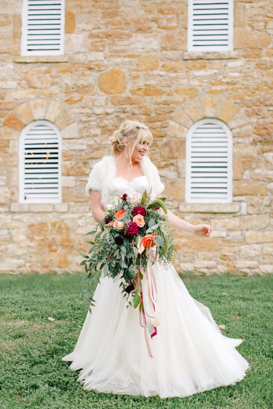 bride in white classic wedding dress with fall inspired bouquet