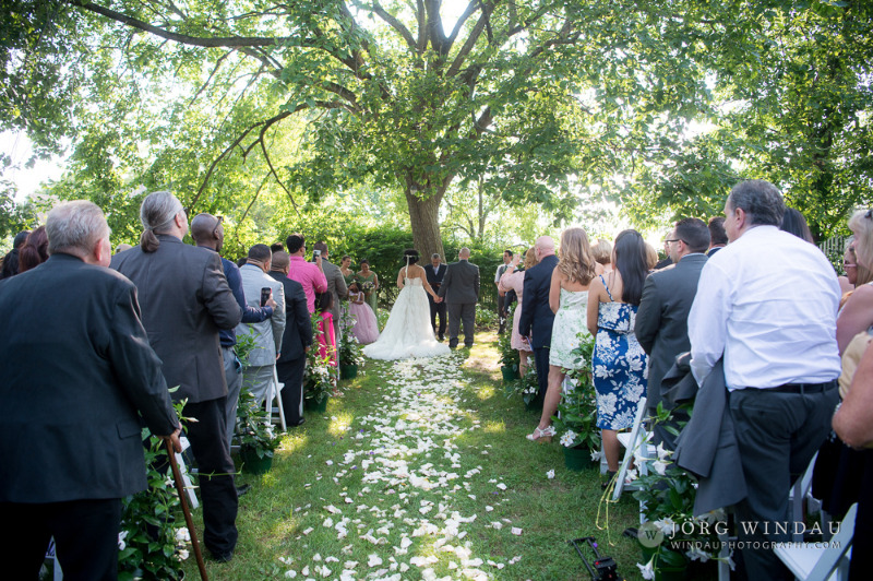 Wedding ceremony at FEAST at Round Hill, Hudson Valley wedding venue and caterer. Photo by Windau Photography.
