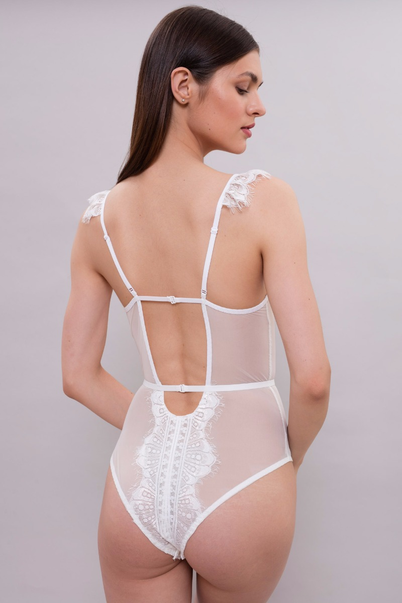 The fitted bodysuit is made of delicate tulle and Chantilly lace.