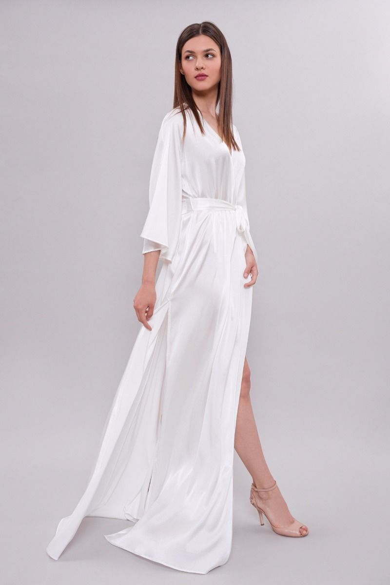 Silk robe with slits on the sides is made of weightless pure silk.