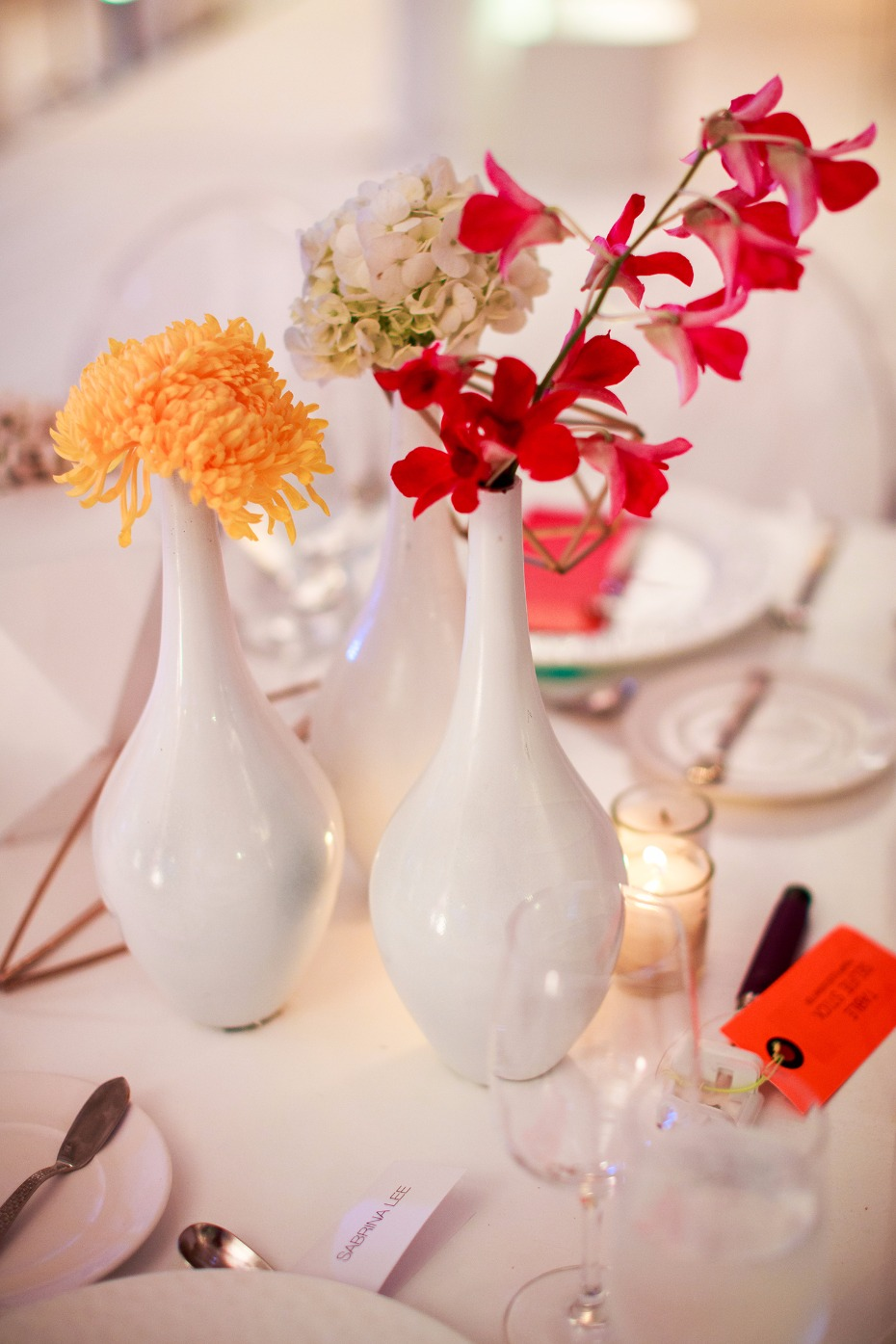 Simple white vases with buds