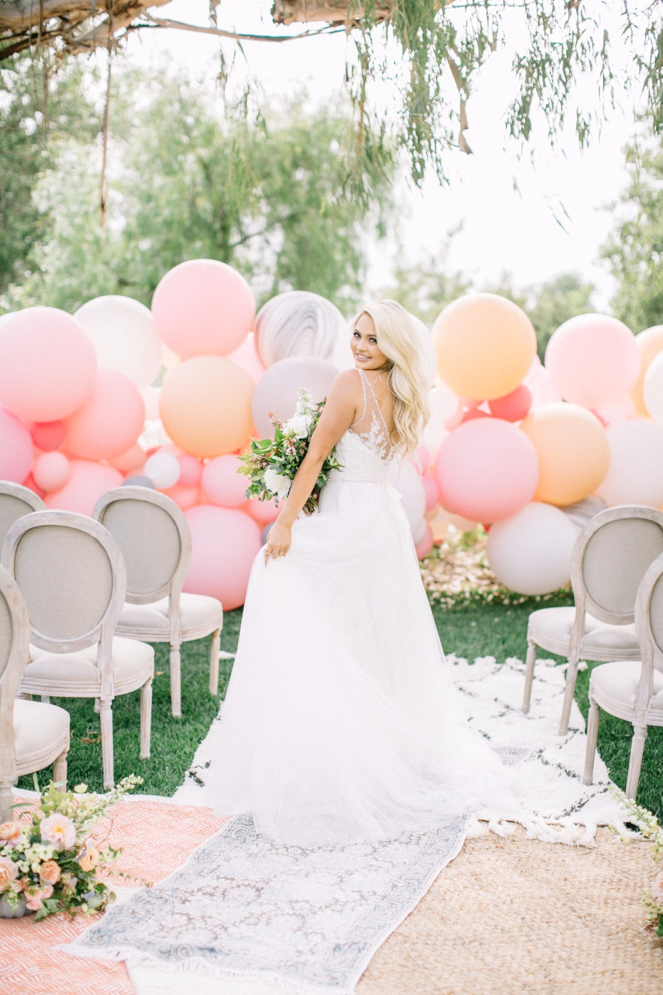 Gorgeous ceremony with balloon backdrop