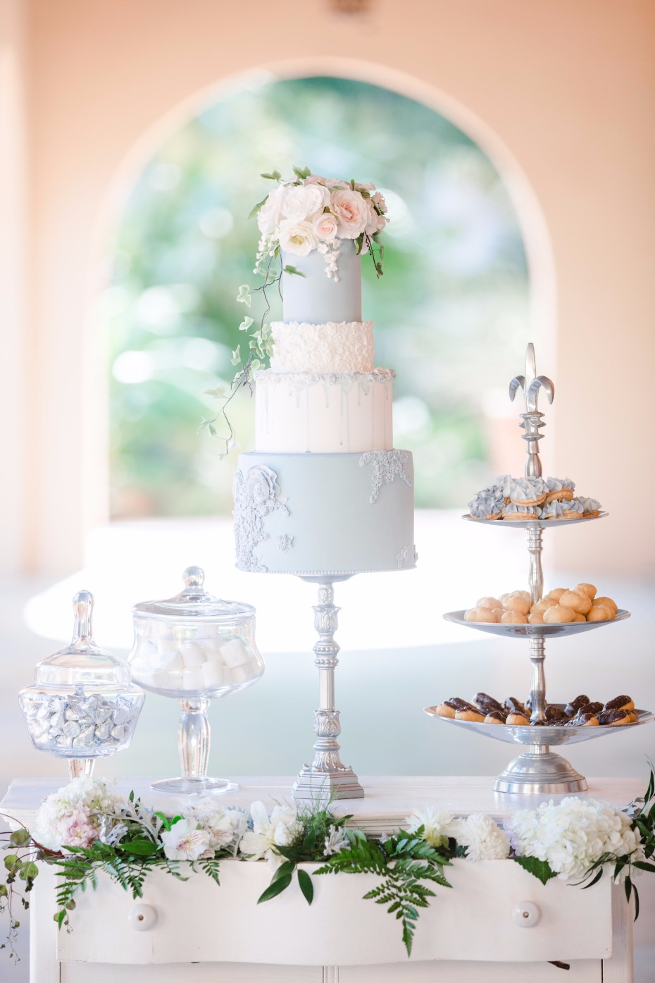 soft blue wedding cake with elegant dessert table