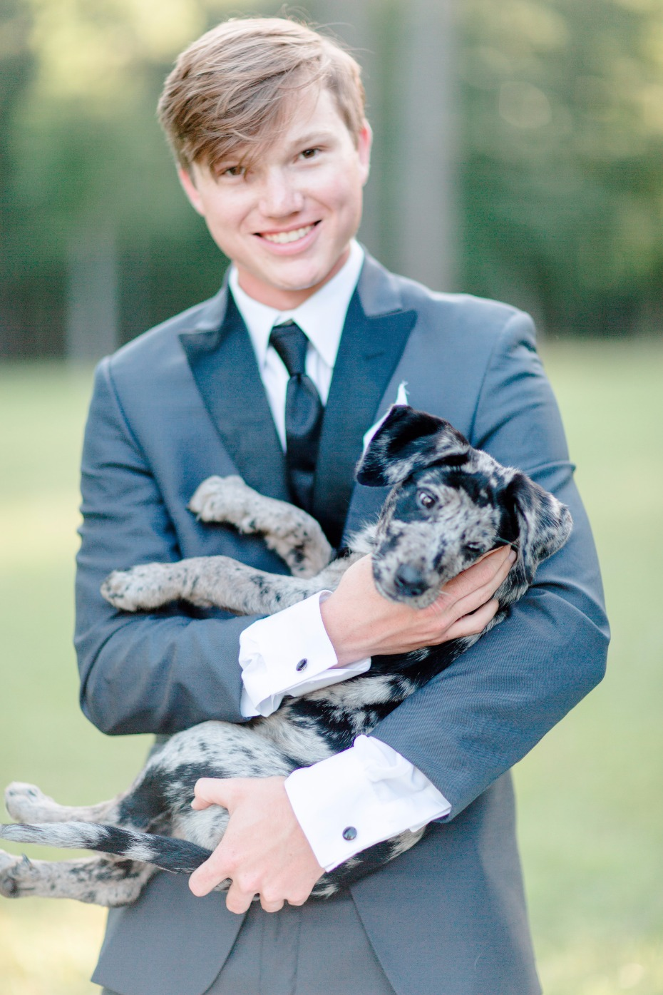 groom and his puppy