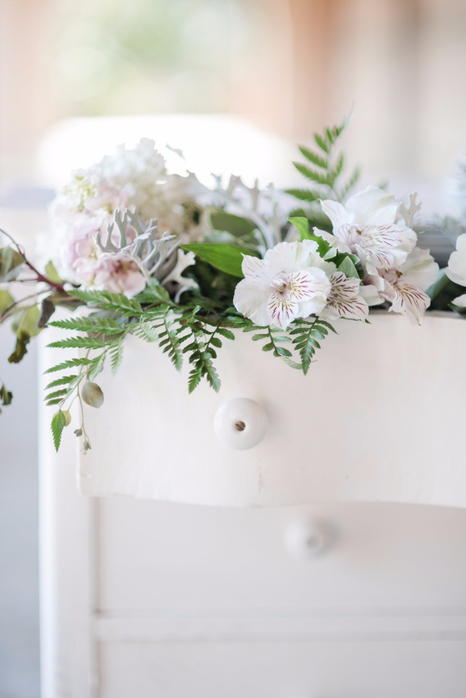 wedding dresser for your cake table filled with flowers