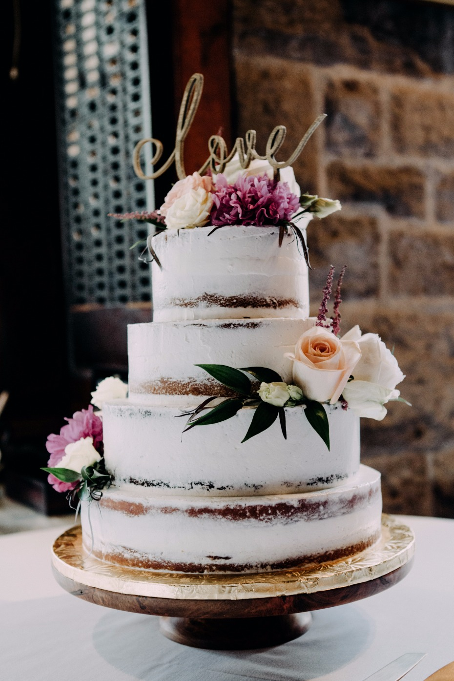 Boho chic naked cake with love topper