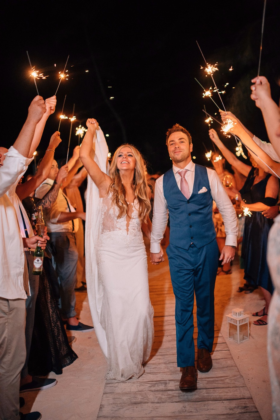 sparkler exit for the bride and groom at their beach wedding