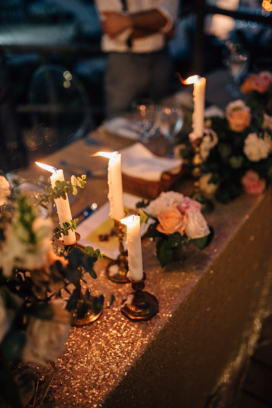 candle lit wedding reception with vintage candlesticks