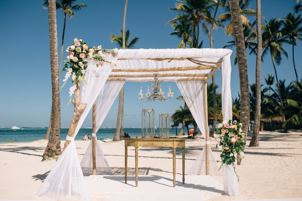 charming white and gold dreamy beach wedding altar