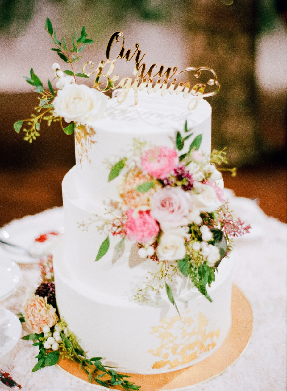 our new beginnings wedding cake with floral toppers