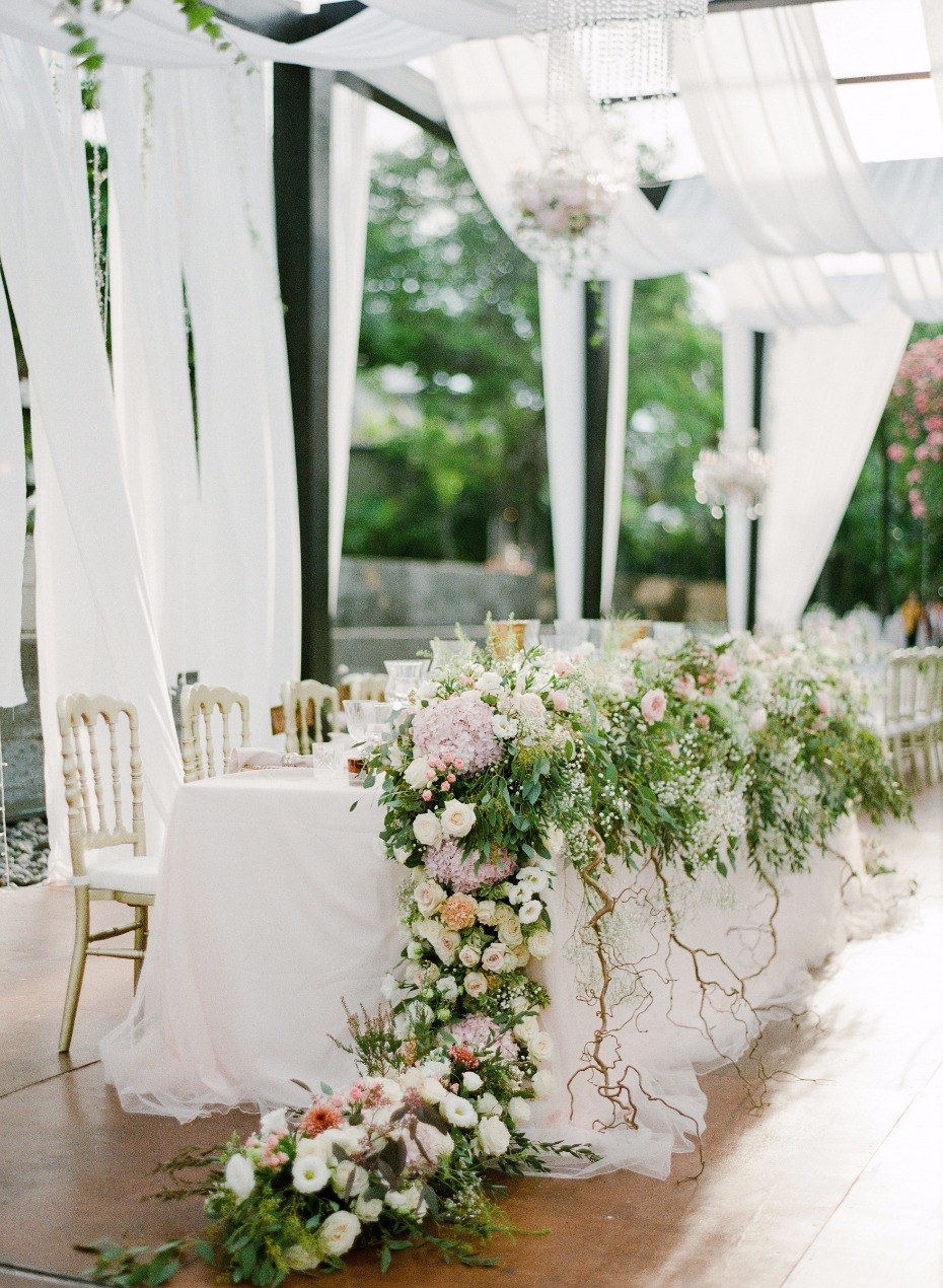 wedding party table with a practical garden cascading down the sides of the table