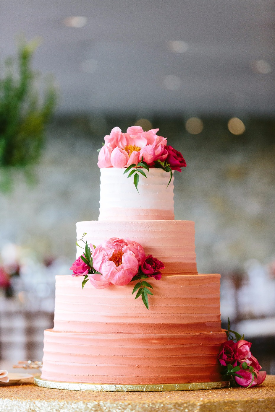 Pink ombre wedding cake with flowers