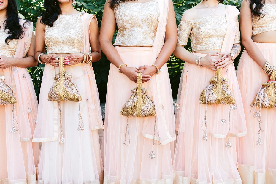 Blush and gold bridesmaid dresses with custom purses