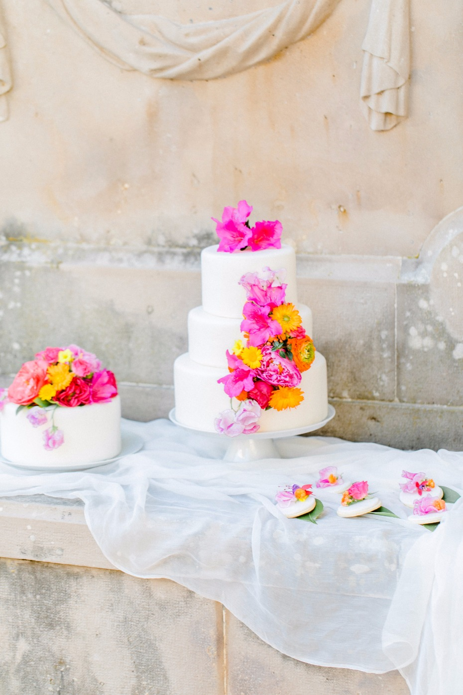 hot pink and orange flower accents for your wedding cak