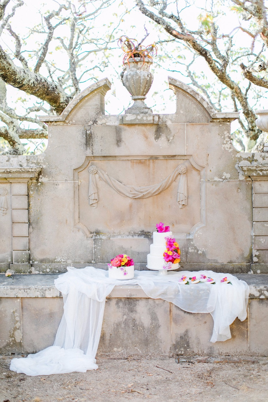 romantic outdoor wedding cake display