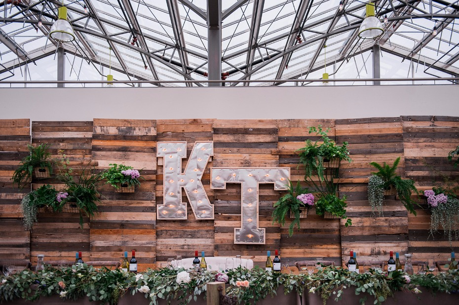 Marquee sign with a rustic wood backdrop