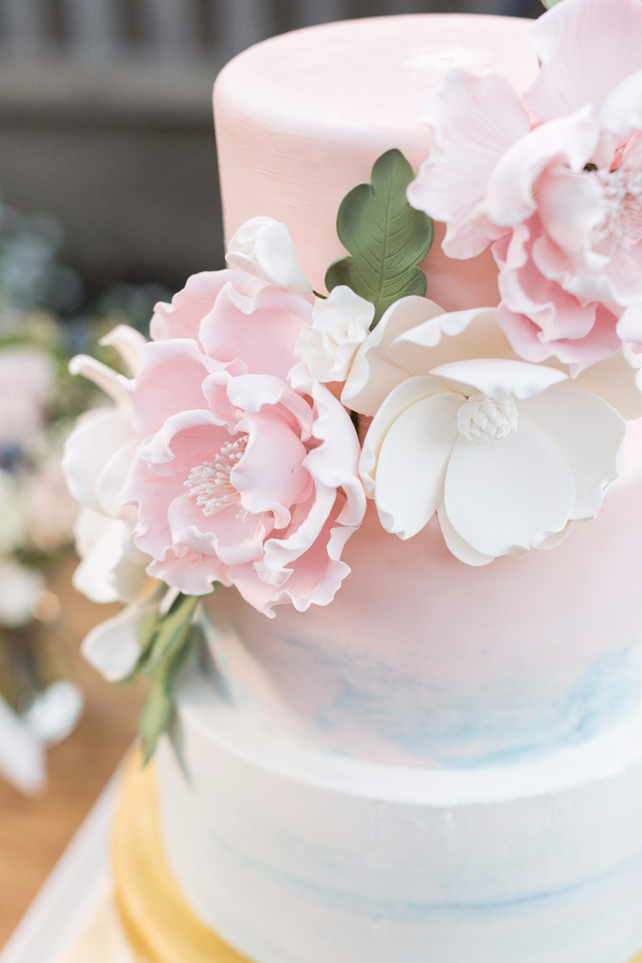 Pink and blue cake with sugar flowers