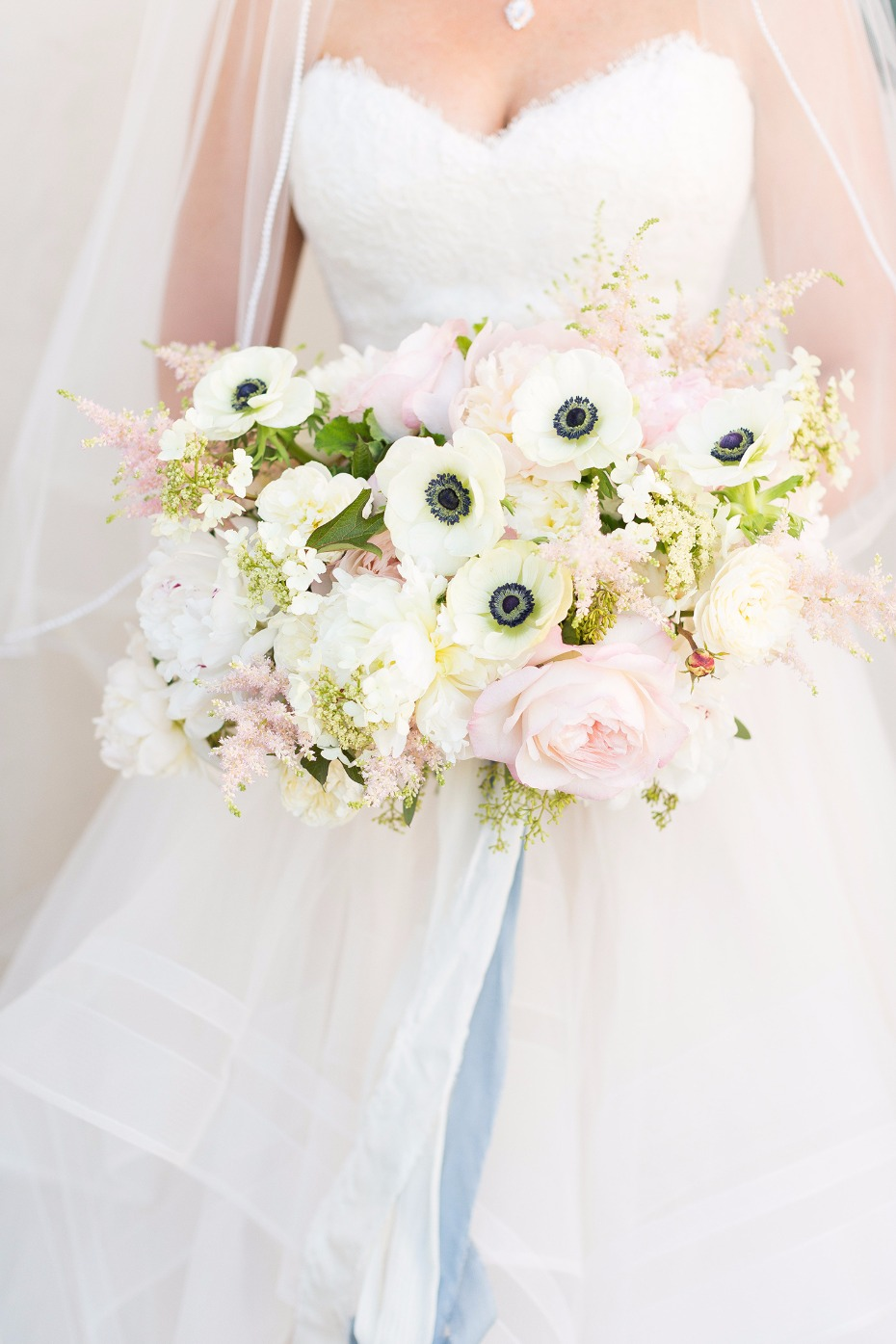 White and blush bouquet with blue ribbon