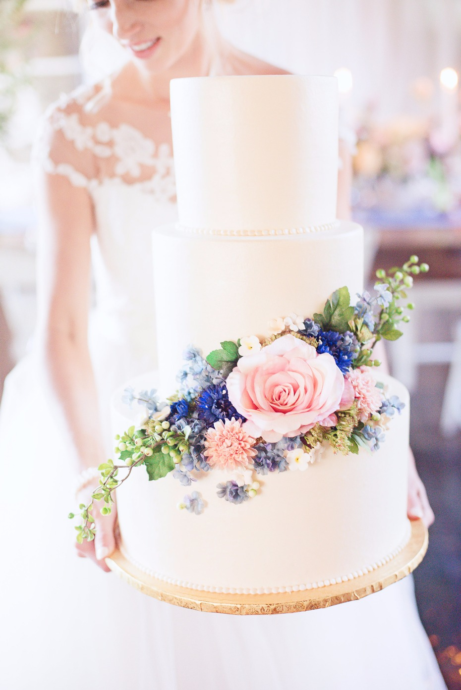 simple and elegant flower accented wedding cake