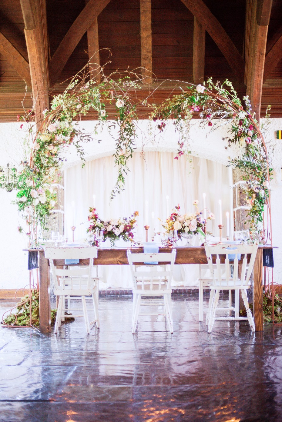 romantic weeping style floral arch for over your wedding table