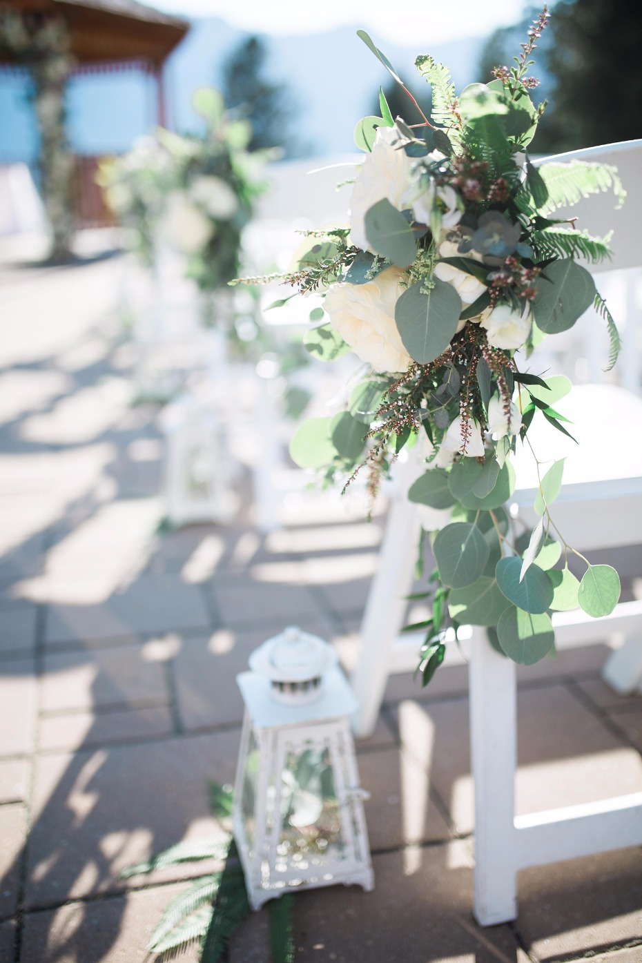 Aisle decor lantern and greenery